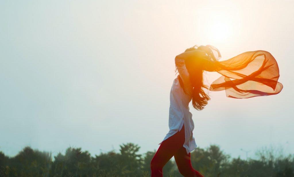Free-spirited woman running